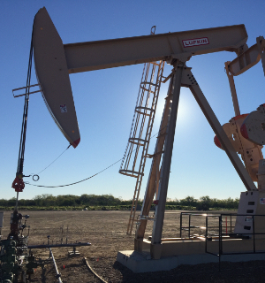 Pump jack on an unconventional shale play